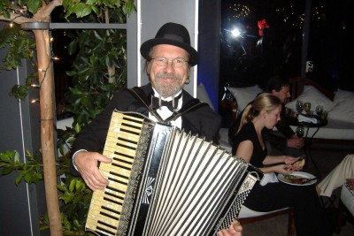 An accordion player politely poses.