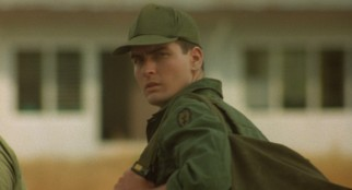 Private Chris Taylor (Charlie Sheen) arrives in Vietnam greeted by dust and dead bodies, the latter of which he's there to replace.
