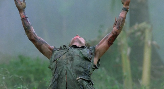 "In the iconic shot by which ""Platoon"" has long been represented, a downed Sgt. Elias (Willem Dafoe) reaches up to the heavens for salvation."