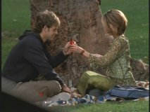 Josh and Lily sitting near a tree, S-I-P-P-I-N-G, first comes cough syrup, then comes marriage...
