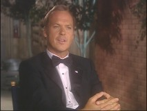 "Michael Keaton is way overdressed for his ""Behind the Microphone"" interview."