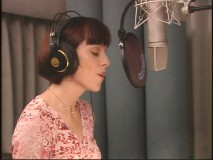 "Susan Egan is quite literally, ""Behind the Microphone"" as she records the lines for Madame Gina."