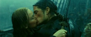 Will (Orlando Bloom) and Elizabeth share a moment in the most unorthodox of romantic scenarios.