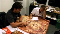 Director Gore Verbinski and designer James Byrkit go over one of the preliminary versions of Sao Feng's map.
