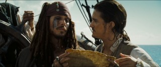 Captain Jack and Will Turner lay out their cards aboard the Black Pearl.