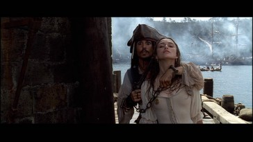 "Captain Jack Sparrow (Johnny Depp) uses Elizabeth Swann (Keira Knightley) as a way to escape in ""Pirates of the Caribbean: The Curse of the Black Pearl."""