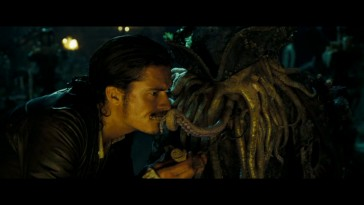 "Will Turner (Orlando Bloom) tries to nab keys from Davy Jones' tentacle beard in ""Pirates of the Caribbean: Dead Man's Chest."""