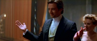 Hugh Jackman plays Robert Angier, a showy Victorian magician.