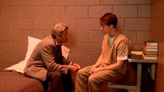 Hotshot Chicago lawyer Martin Vail (Richard Gere) questions his client Aaron Stampler (Edward Norton) in an eerily red-tinted prison cell.