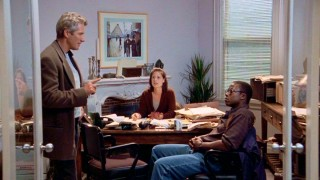 Martin Vail (Richard Gere) talks strategy with his hard-working assistants Naomi (Maura Tierney) and Goodman (Andre Braugher).