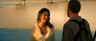 "Brooke Langton plays ""animal reporter"" Aviva Masters, smiling like a movie's obligatory attractive female ought to."