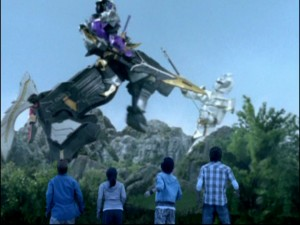 In this very convincing shot, the rangers-to-be watch a robotic centaur fight a foe.