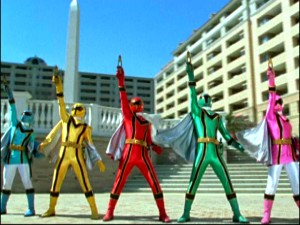 The Power Rangers use their cell phones to summon magic forces. [Standard text messaging rates may apply.]