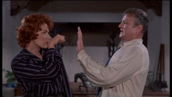 Maureen O'Hara's knuckles or Brian Keith's palm: which are you putting your money on?