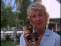 "Susan Henning shows off her Duckster award in ""Who's the Twin?"""