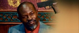 Not even a floating gun by his temple can shake the cool confidence of the Division's ruthless high-ranking agent Henry Carver (Djimon Hounsou), the movie's villain.