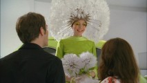 In this show's world, a spokeswoman (Riki Lindhome) dressed as a dandelion isn't a very peculiar sight.