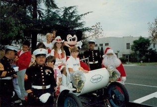 Priscilla, with Mickey Mouse, spreads holiday cheer at the 1984 Bakersfield Christmas Parade.