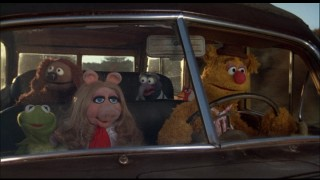 Fozzie and company are movin' right along in their upgraded vehicle.