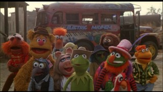 The Muppets stand as tall as they can faced by Doc Hopper and a gang of baddies.