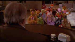 Having made it to Hollywood, the Muppets stand before the powerful movie executive Lew Lord (Orson Welles).