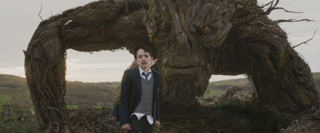 "In ""A Monster Calls"", a large tree-like monster (voiced by Liam Neeson) visits a bullied boy (Lewis MacDougall) with a sick mother."