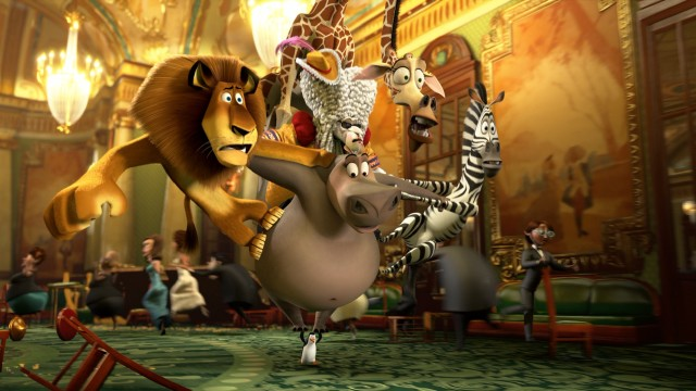 "Alex, Gloria, Melman, Marty, and two chimps disguised as the King of Versailles make a messy getaway from a Monte Carlo casino on a penguin's flippers in ""Madagascar 3: Europe's Most Wanted."""