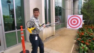 "Head of Effects Scott Peterson tests out a banana gun in the name of research in ""Ringmasters."""