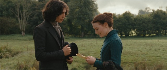 Worldly young law clerk Léon Dupuis (Ezra Miller) impresses Emma Bovary (Mia Wasikowska) with the gift of a Parisian map.