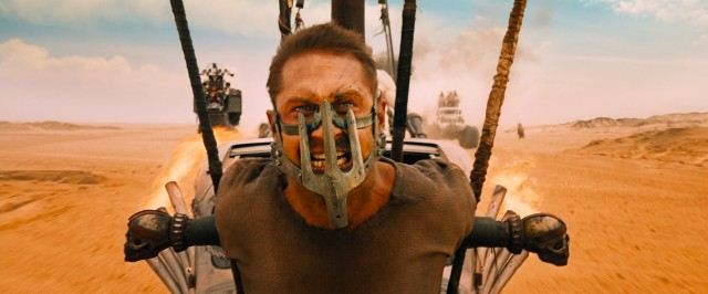 "Chained and masked Max Rockatansky (Tom Hardy) functions like a hood ornament in ""Mad Max: Fury Road."""
