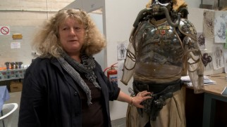 Costume designer Jenny Beavan shows off the unusual outfit of Immortan Joe.