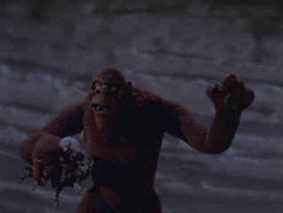 It, a giant ape resembling King Kong, holds the comparably diminutive Mad Monster Party cast in his hand in the film's climax.