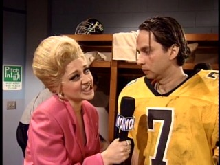 "The Vancome Lady (Nicole Sullivan) obnoxiously interviews a quarterback (David Herman) after a loss in the ""Superbowl Special."""