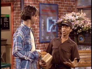 The hyperactive UBS delivery man (Phil LaMarr) annoys a beggar (David Herman).