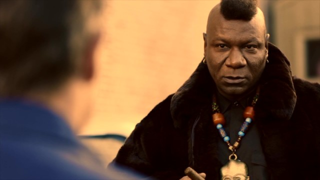 Renoz Wes (Ving Rhames) pities the fool who doesn't go around with a mohawk, medallion necklace, and cigar.