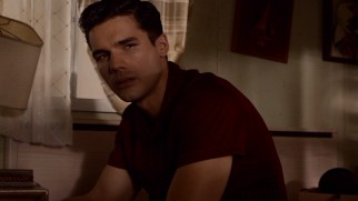 Stevie (Steven Strait) scours a blackmailer's boat house to destroy his incriminating evidence.