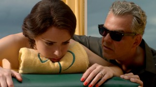"Mobster Ben ""The Butcher"" Diamond (Danny Huston) unsettles his wife Lily (Jessica Marais) by taking over her massage."