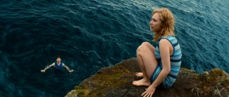 Alicia (Juno Temple) has second thoughts about making this jump off rocks.