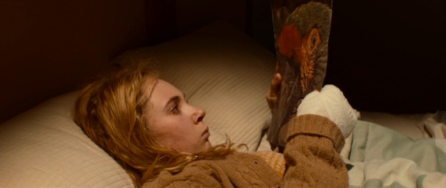 "Insomniac Alicia (Juno Temple) finds a parrot photograph with an apology under her pillow in ""Magic Magic."""