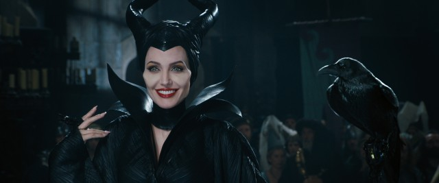 "Maleficent (Angelina Jolie) crashes the christening of the infant princess Aurora in Disney's ""Maleficent."""