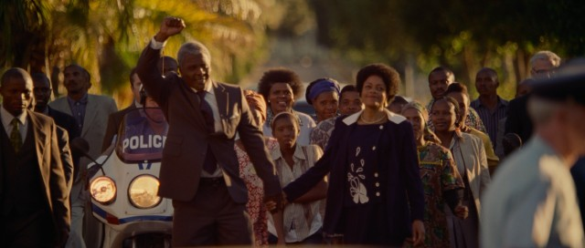 Nelson Mandela (Idris Elba) makes a fist as he walks out from prison with Winnie (Naomie Harris) by his side after serving 26 years of a life sentence.