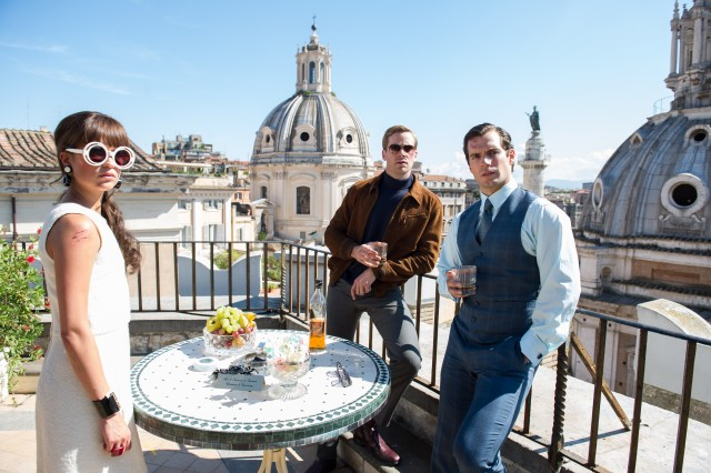 "Gaby Teller (Alicia Vikander), Illya Kuryakin (Armie Hammer) and Napoleon Solo (Henry Cavill) strike a pose in the closing shot of ""The Man from U.N.C.L.E."""