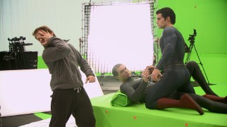 "Director Zack Snyder shows Michael Shannon (General Zod) and Henry Cavill (Superman) what he's looking for in their green screen duel in ""All-Out Action."""