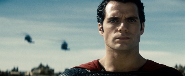 "With military choppers behind him, Superman (Henry Cavill) presents himself to Zod as demanded in ""Man of Steel."""