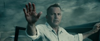 Jonathan Kent (Kevin Costner) waves off help in the midst of a devastating tornado flashback.