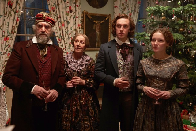 Charles Dickens (Dan Stevens) celebrates Christmas 1843 with his father (Jonathan Pryce), mother (Ger Ryan), and wife (Morfydd Clark).