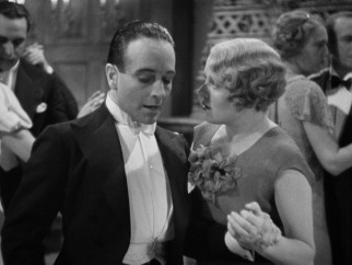 Dying spy Louis Bernard (Pierre Fresnay) slips Mrs. Lawrence (Edna Best) some important information.
