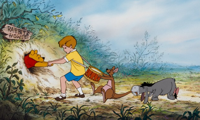 "Christopher Robin, Kanga, and Eeyore try to help get Winnie the Pooh unstuck from Rabbit's doorway in the first third of ""The Many Adventures of Winnie the Pooh."""