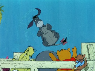 "A gloomy Eeyore gets in the way of a game of Pooh-sticks in the 1983 short ""Winnie the Pooh and a Day for Eeyore."""