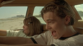 Hank (Leonardo DiCaprio) introduces Bessie (Diane Keaton) to the thrills of driving along an ocean shoreline.